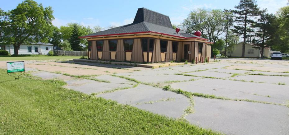 A vacant restaurant space is pictured on a concrete parking lot in Geneva, NE. The 1978 building last housed a Pizza Hut, but would be ideal for retail or commercial space, too.