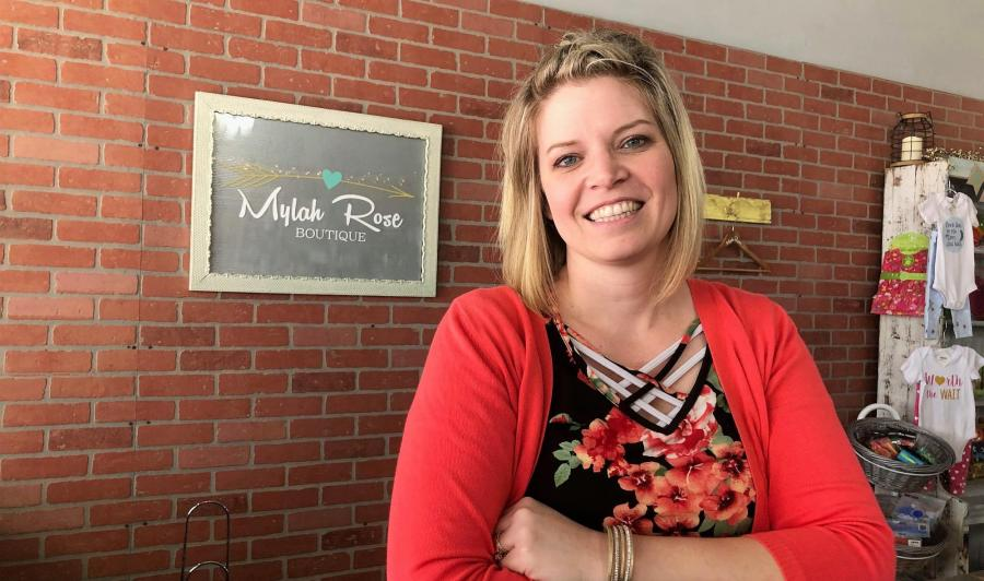 Nicole Schoenholz is pictured at the counter in Mylah Rose Boutique in Geneva, NE