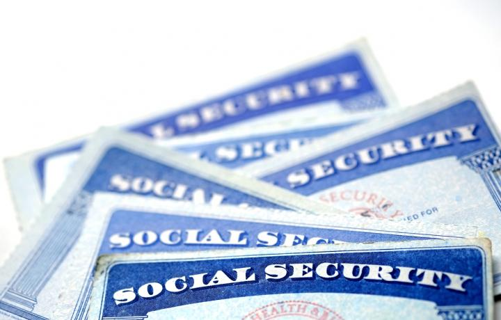 An assortment of the familiar blue social security cards are pictured in this illustration.