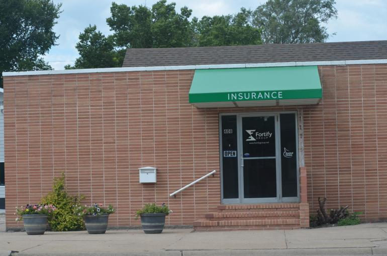 Our North Platte office is pictured. The square brick building has a bright green awning facing Jeffers St.