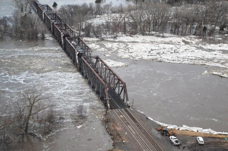 A bridge is partially submerged in this photo from Nebraska's historic flooding in March of 2019