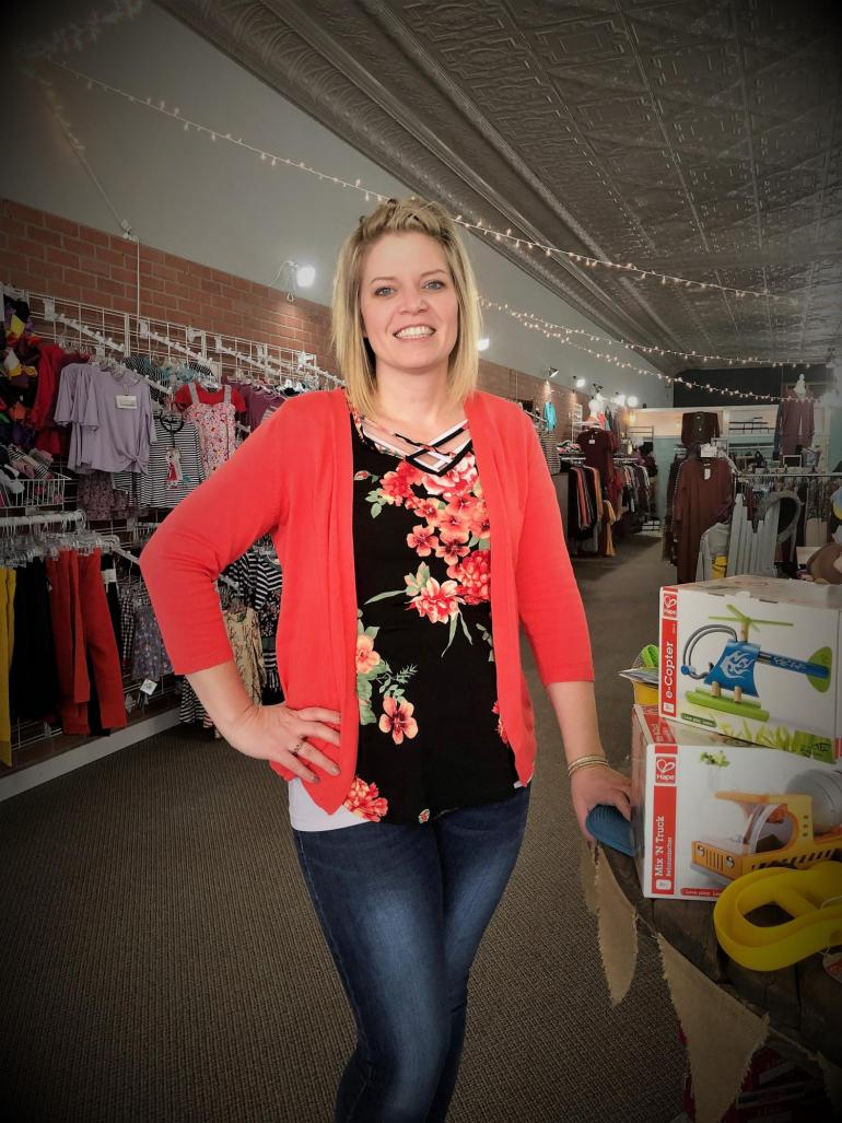 Nicole Schoenholz is pictured by a toy display inside Mylah Rose boutique in downtown Geneva, NE
