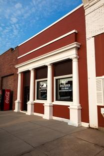 Fortify Group's Shickley location is pictured. The building has bright red brick and white columns.